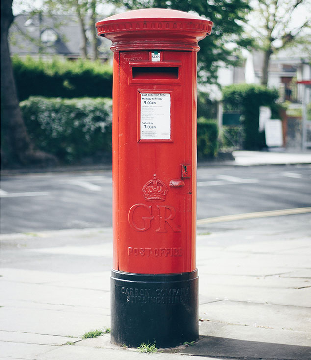 A post box with the initials GR